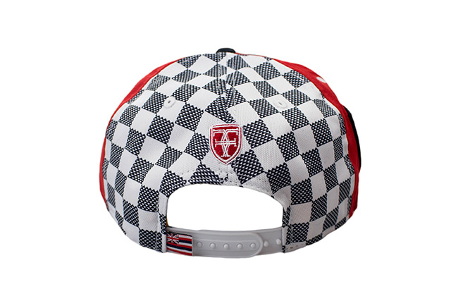 17e72675b29241 An all-around clean Kamehameha snapback for the keiki, featuring a black  crown and visor along with a red undervisor and a white snap enclosure.