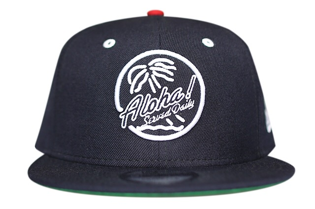 The navy Brigante snapback features white embroidery 3f8bd614179